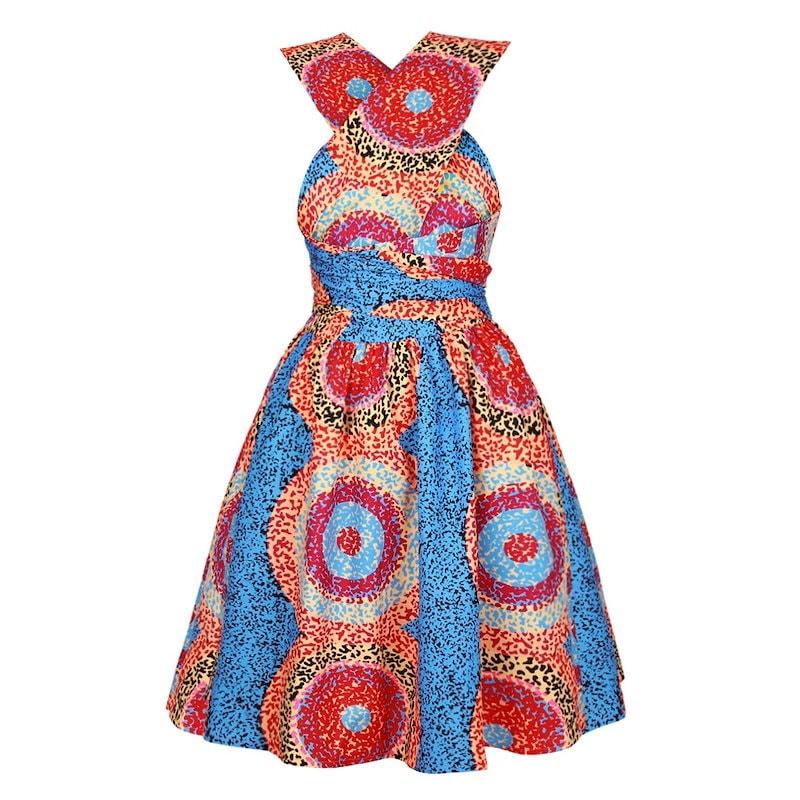 デジタルプリーツスカートブラを着用し、アフリカのさまざまな要素を印刷します