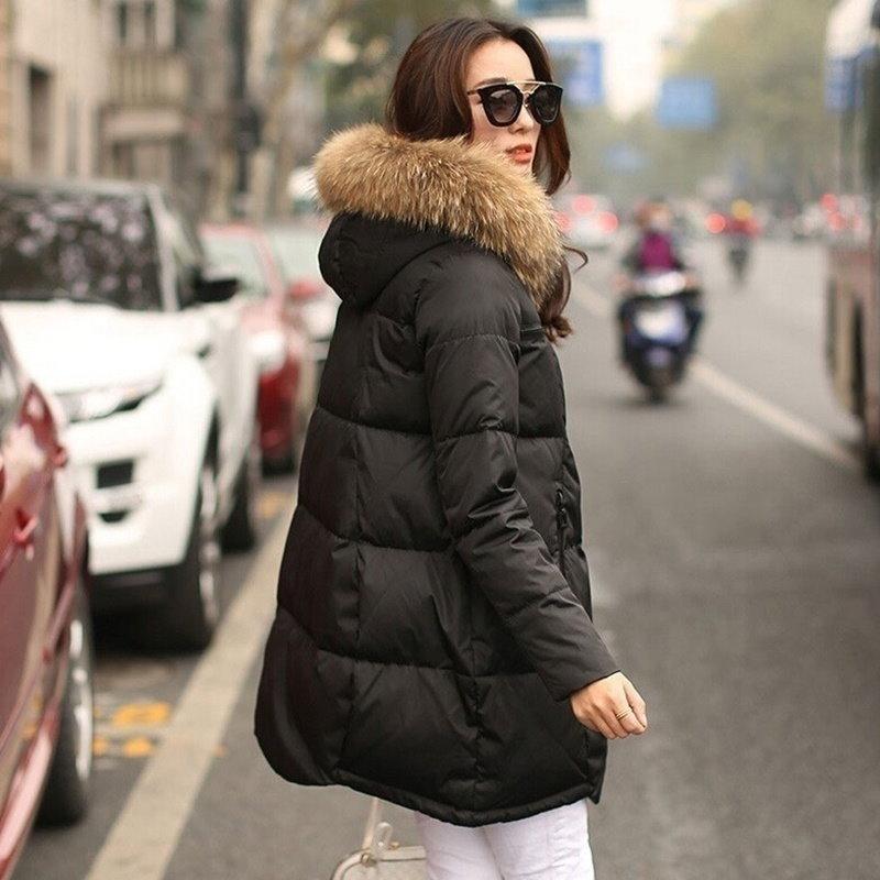 冬の女性ピュアカラーロングダウンコート