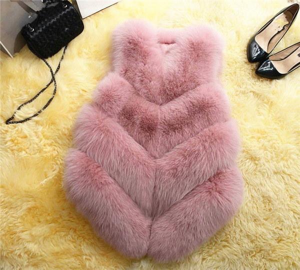 女性のフェイクファーの外套冬のノースリーブウォームソリッドカラー毛皮のコート