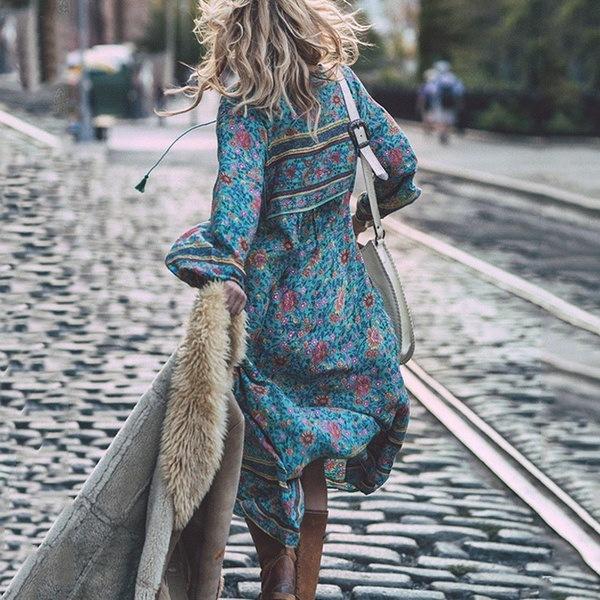 女性の夏の春美しいVネックルーズビーチドレスボヘミアタッセル不規則な裾花のプリントD