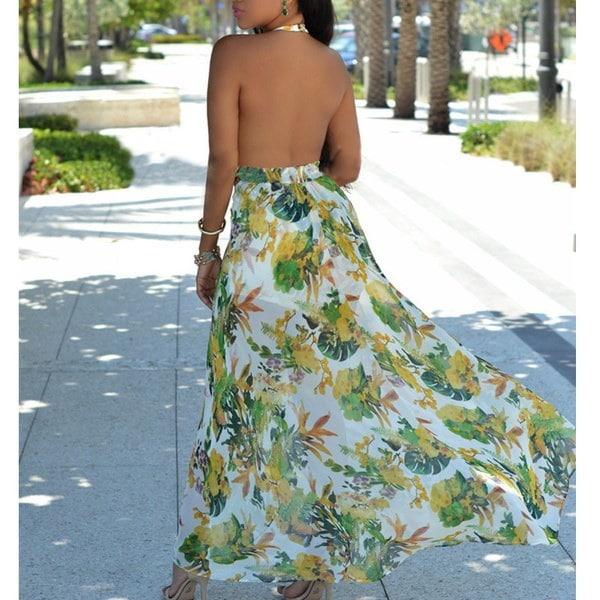 女性のファッション花のプリントホルターネックのロンパージャンプスーツとマキシドレス