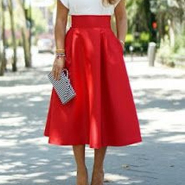 ファッション女性のラインフレアプリーツ女性のソリッドプレーンカジュアルヴィンテージエレガントなポケットミディスカート