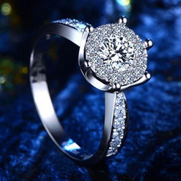 2016スタイリッシュなファッション絶妙なシルバーリングジュエリー女性のためのロマンチックな結婚指輪ファッションジルコンニュ
