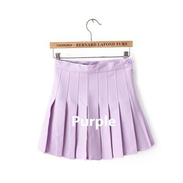 女の子はAラインサイドボタンテニススカートをプリーツ