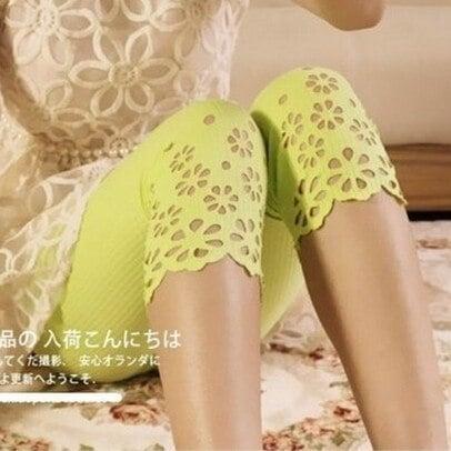 新しい夏の女性の短いレギンスコットンニット空洞のアウトアイアンフラワーソリッドパンツ