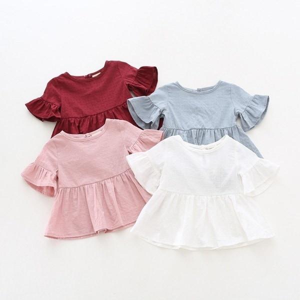 夏の赤ちゃんの女の子のシャツ幼児の綿の半袖ロータリーリーフブラウス