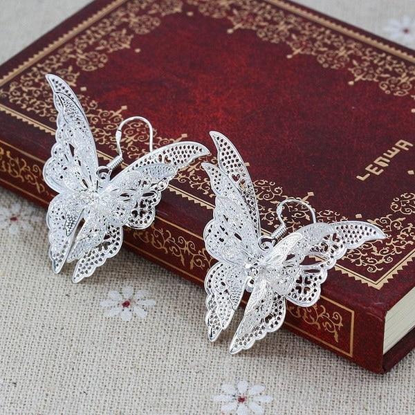 新しいファッション耳珠の宝石925純銀製の女性のチャーミングな蝶のぶら下がっフックのイヤリング