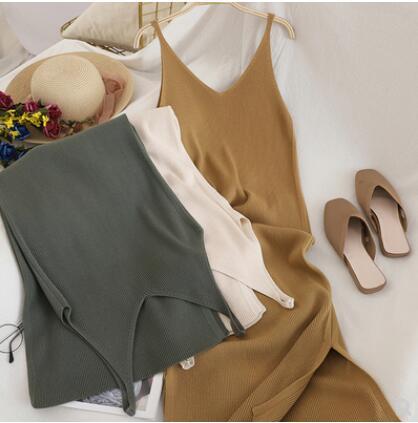 新型の韓国版の編み物のワンピースの女性の内はVネックを掛けて底のスカートを打って身を修めてやせている長いスカートが現れますtz720