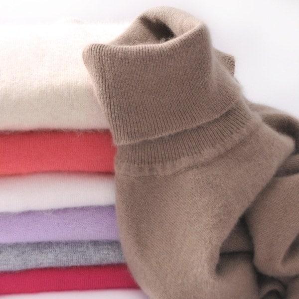 最新のウール純粋なカシミアセーター女性の厚いプルオーバープルメンハイネックのセーターのプルプルをプル